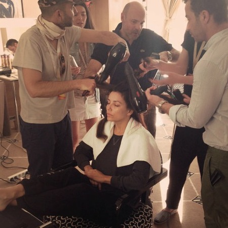 Eva Longoria gets her hair styled by four men at Cannes 2013