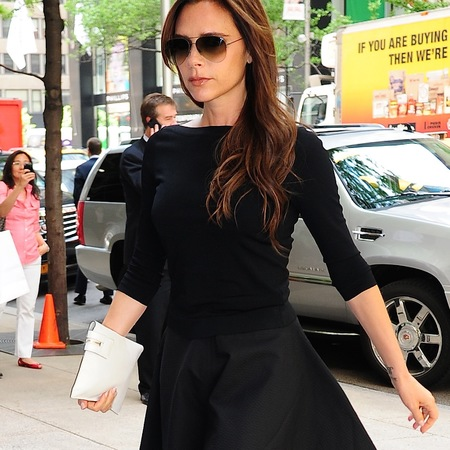 Victoria Beckham's white clutch bag and black dress