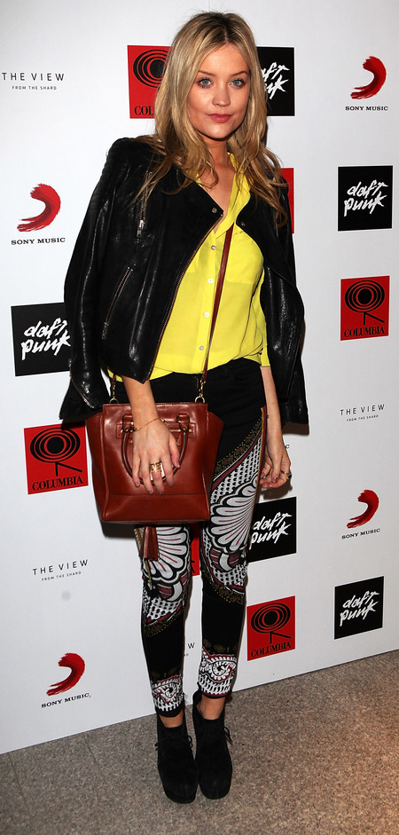 Laura Whitmore at Daft Punk party with Coach handbag
