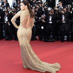 CANNES: Eva Longoria wows in gold Zuhair Murad