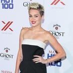 Miley Cyrus styles sexy Valentino jumpsuit at Maxim Hot 100 party