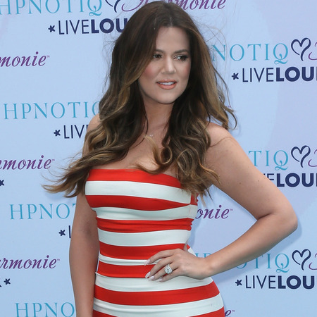 Khloe Kardashian stuns in red and white bodycon stripes and Kanye West heels