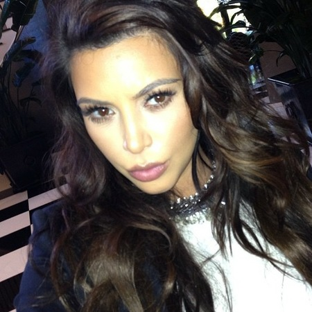 Kim Kardashian doing tousled waves