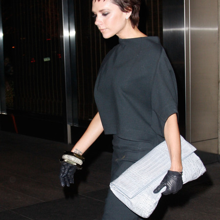 Victoria Beckham's oversized clutch and leather glove