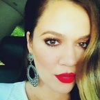 Khloe Kardashian shows off perfect red pout