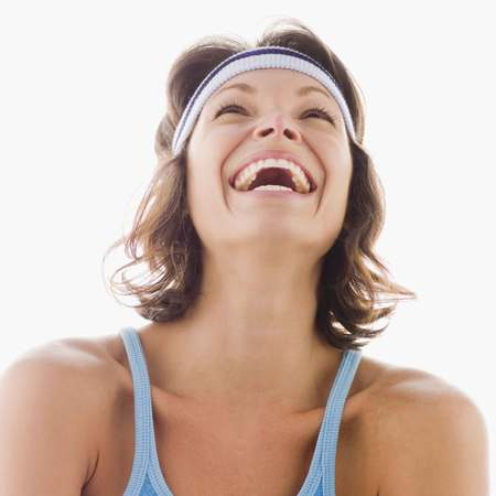 Woman laughing after a workout