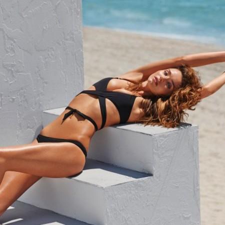 Miranda Kerr modelling swimwear for Net-a-Porter