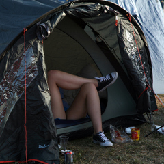 Man in a tent at Bestival