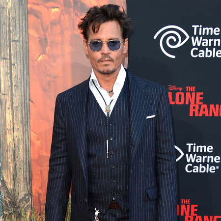 Johnny Depp in Ralph Lauren at 'Lone Ranger' Premiere