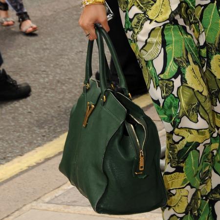 The Saturdays Vanessa White with big colourful handbag