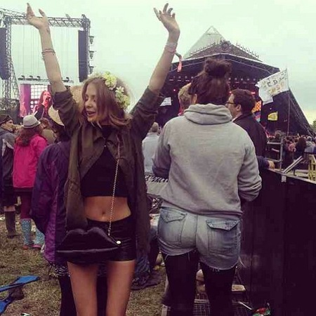 Millie Mackintosh wears Lulu Guinness Lips bag at Glastonbury Festival 2013