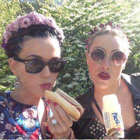 Katy Perry eats a hotdog