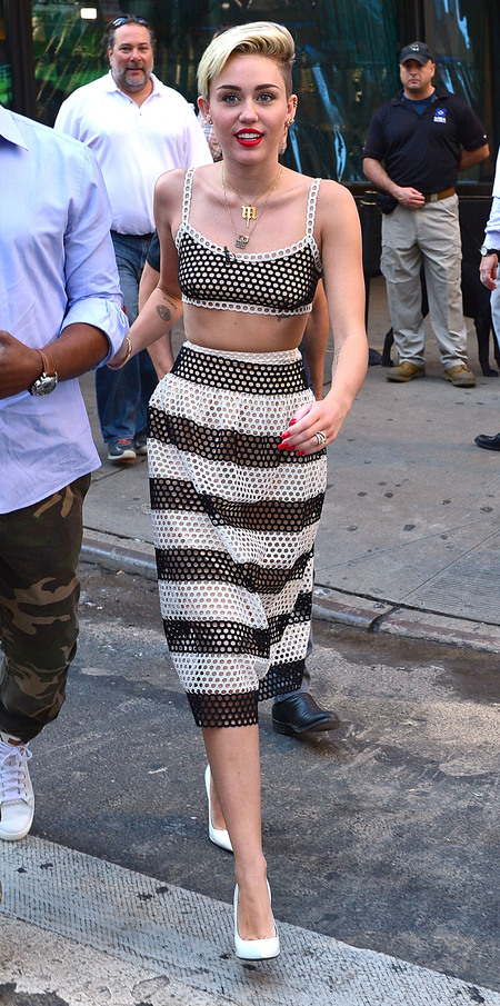 Miley Cyrus rocks fishnet crop top & skirt on Good Morning America