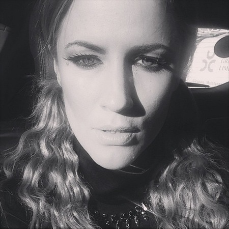 Caroline Flack with her hair in bunches