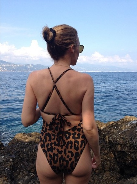 Kylie Minogue flashes famous derriere in leopard print swimsuit