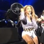 Beyoncé gets her hair stuck in a fan, but styles it out