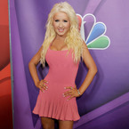 Christina Aguilera flaunts her figure in pink dress