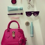 Miranda Kerr reveals summer handbag essentials