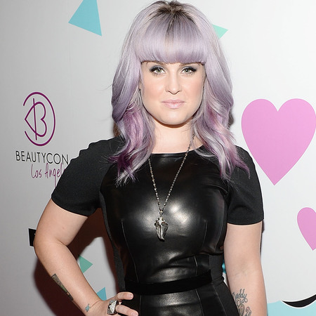 Kelly Osbourne in leather dress with new fringe