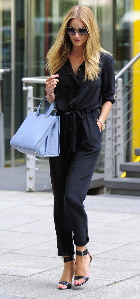 Rosie Huntington Whiteley in Gerard Darel jumpsuit and Armani handbag