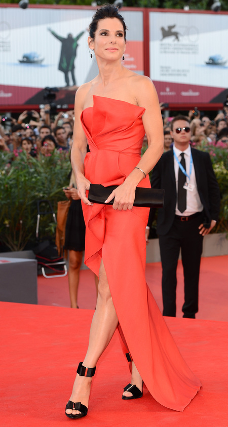 Sandra Bullock in a dip hem dress