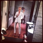 Cara Delevingne suits up in white Burberry tailoring