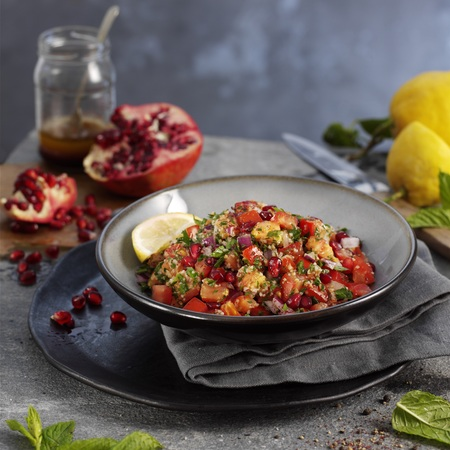 Middle Eastern Tabbouleh salad with red onion, pomegranate and mint