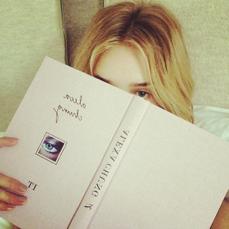 Rosie Huntington Whiteley reading It by Alexa Chung
