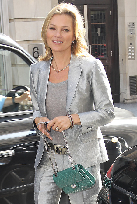 Kate Moss silver suit and Chanel handbag at Christies portrait auction