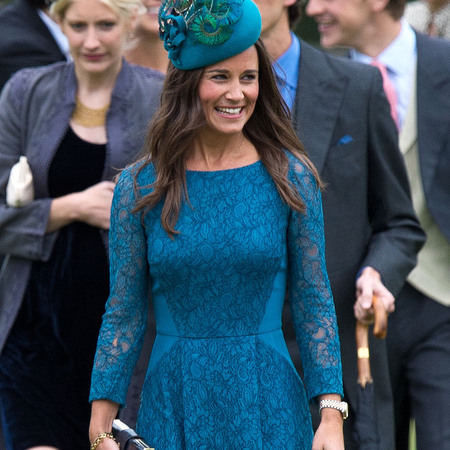 Pippa Middleton at society wedding of James Meade and Lady Laura Marsham wearing Tabitha Webb