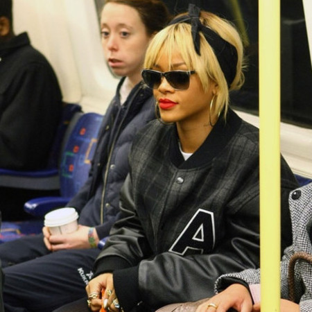 Rihanna wears baseball jacket on the Tube