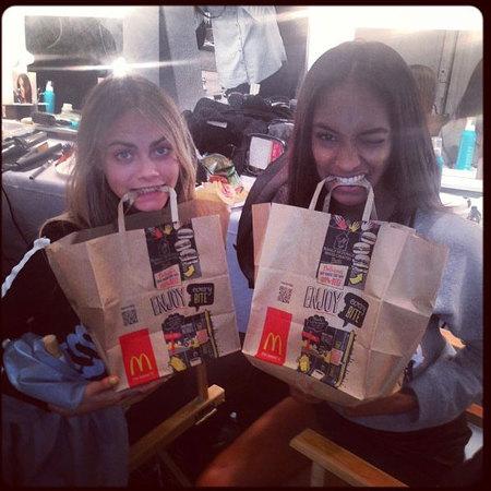 Cara Delevingne and Jourdan Dunn eating McDonald's takeaway at London Fashion Week SS14