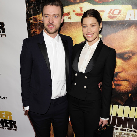Justin Timberlake and Jessica Biel in matching suits at Runner Runner premiere
