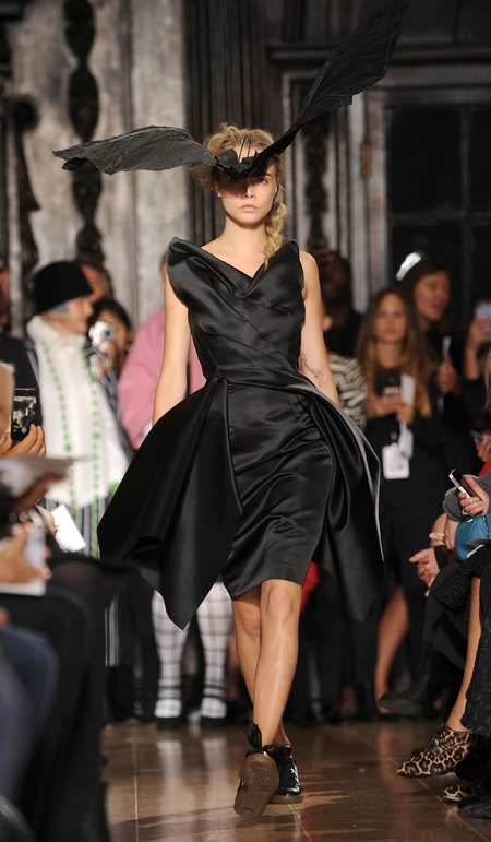 Cara Delevingne in bat hat at Giles Deacon SS14 LFW