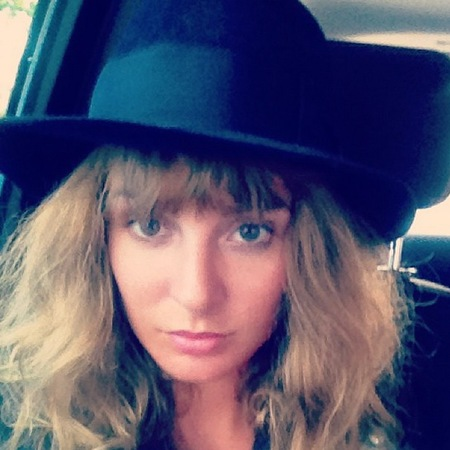 Millie Mackintosh with big hair, hat and fringe