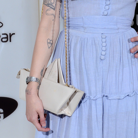 Peaches Geldof in lilac/blue dress with white handbag shaped like a sailboat