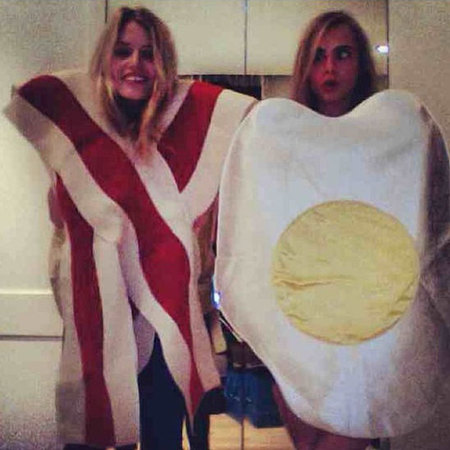 Cara Delevingne and Georgia May Jagger dressed up as egg and bacon