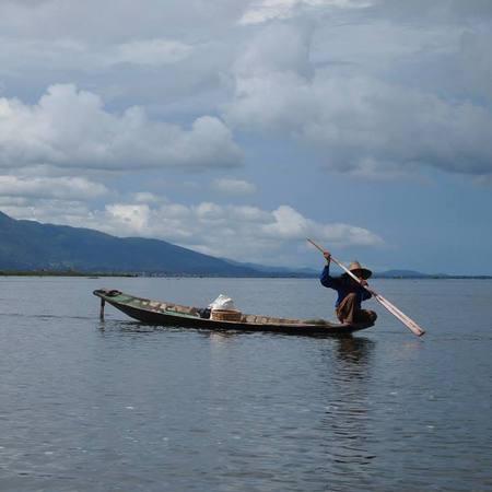 Man on boat fishing, Burma