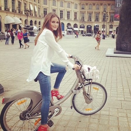 Olivia Palermo cycling in red high heels at Paris Fashion Week SS14