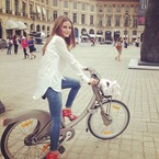 Olivia Palermo cycles in stilettos at Paris Fashion Week