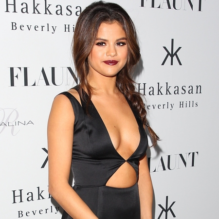 selena gomez - extreme cleavage trend - pluning black dress - flaunt magazine party 2013 - handbag.com