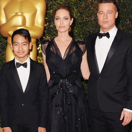 angelina jolie in black lace versace dress - Angelina and Brad Pitt with son Maddox 0 governors ball awards 2013 - handbag.com