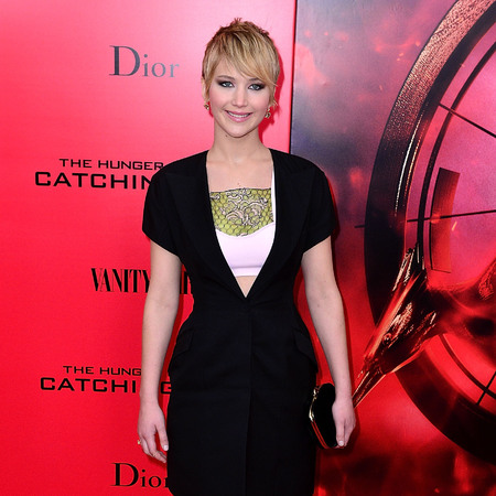 Jennifer Lawrence Hunger Games premiere - Dior dress - red carpet fashion - film premiere - fashion news - handbag.com