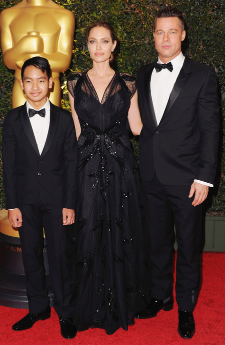 angelina jolie in black lace versace dress - Angelina and Brad Pitt with son Maddox 0 governors ball awards 2013 - handbag.com