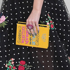 Katy Perry does the book clutch bag trend