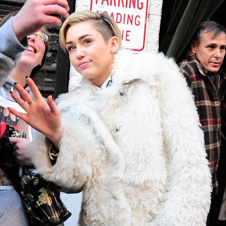 Miley Cyrus - new york sightings - white coat - fluffy coat trend - handbag.com