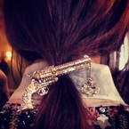 Gunpoint ponytails & big bow hairstyles at Chanel