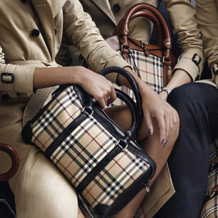 resized malaika firth and jaime campbell bower - burberry ss14 ad campaign - burberry trench coats and check print handbags - handbag.com