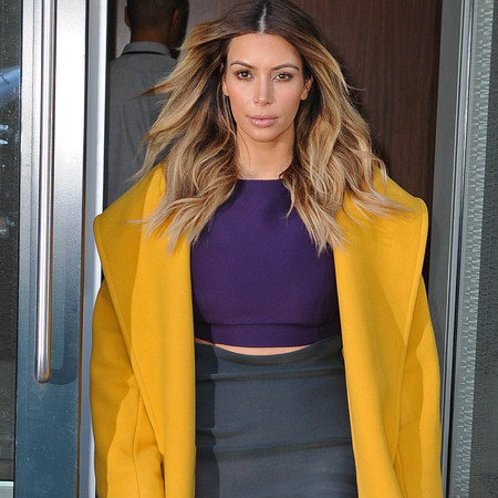 kim kardashian in yellow coat - purple crop top and green pencil skirt - celebrity fashion trend - handbag.com