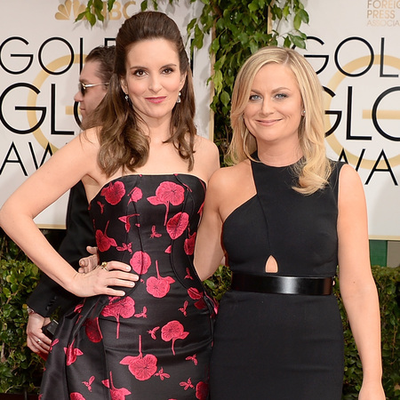 Tina Fey and Amy Poehler at the Golden Globe Awards - Red carpet fashion - Golden globe presenters - female friends celebrities - working with your friend - celebrity fashion - life and fashion news - handbag.com